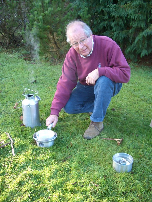 John Grindlay beside a STORM Kettle and using the STORM CookKit