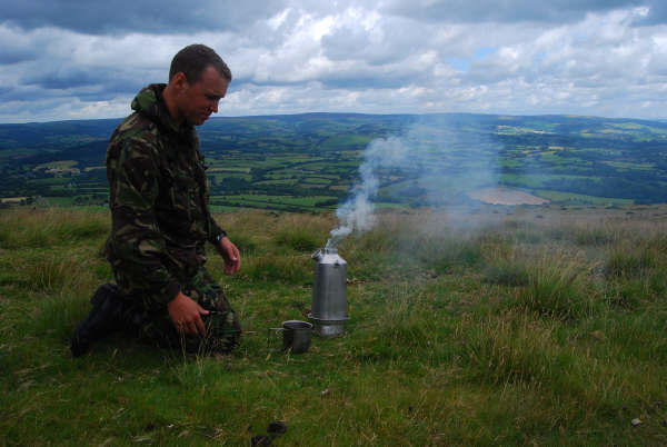 A STORM Kettle steaming away at the top of a hill in Wales with wonderful scenic view